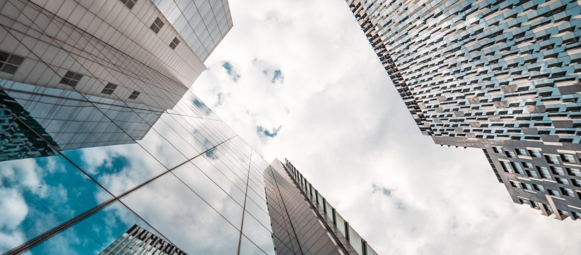 low-angle-photography-of-glass-buildings-2529179
